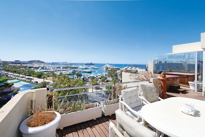 Terrace of a property on Ibiza, overlooking the harbor and the sea