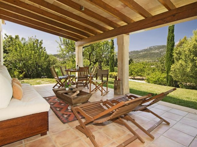 Terrace of a finca with views of the village Selva